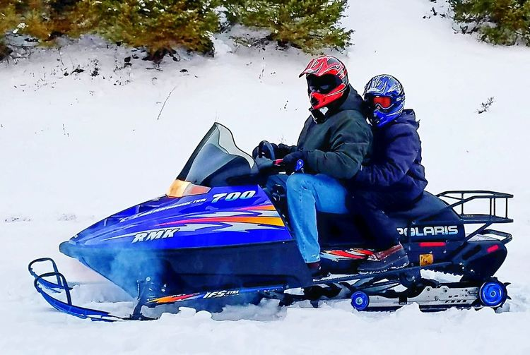 Snowmobile Riding Montana Winter Cold Temperature Two People Sport Adventure Outdoors