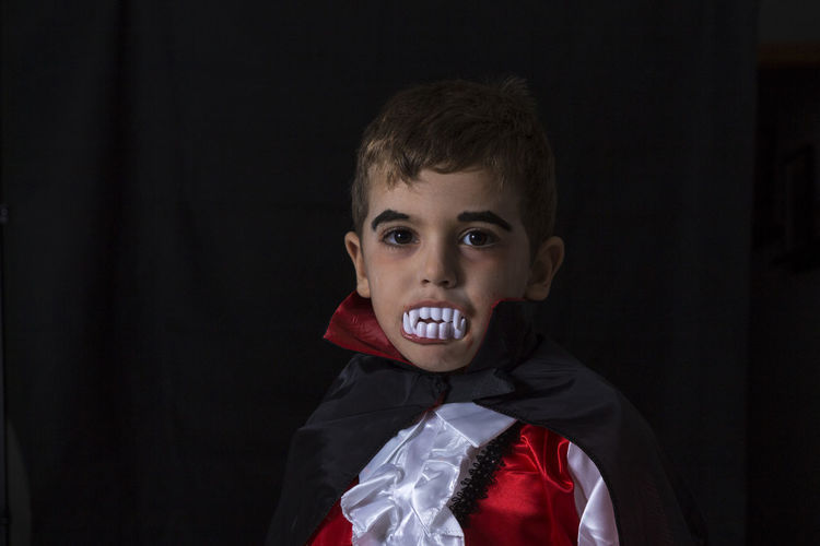 Vampire Custom Dark Dracula Makeup Black Background Boys Child Childhood Children Only Costume Day Face Paint Front View Halloween Headshot Indoors  Leisure Activity Lifestyles Looking At Camera One Boy Only One Person People Portrait Real People Stage Costume Vampire