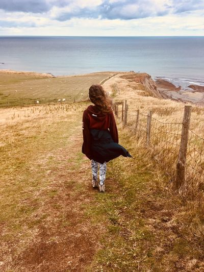 My daughter on The Cleveland Way EyeEm Selects Land Real People Sky Leisure Activity Beach Water Rear View Lifestyles Beauty In Nature Nature Sea One Person Adult Horizon Over Water Full Length Women Day Horizon Outdoors Autumn Mood Moments Of Happiness 2018 In One Photograph International Women's Day 2019