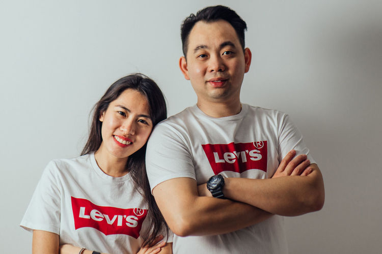 Looking At Camera Two People Portrait Front View Young Adult Indoors  Casual Clothing Waist Up Text Young Men Standing Western Script Emotion Studio Shot People Adult Young Women Smiling Women Positive Emotion Levis LEVIS™ Couple Love