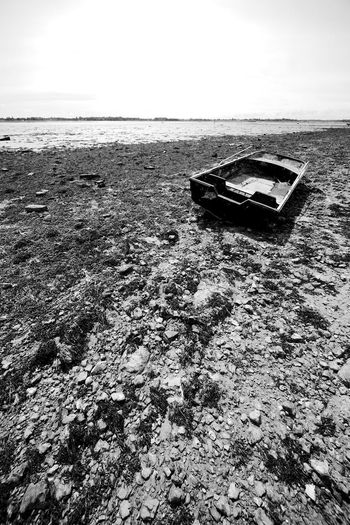 Abandoned Boat Abandoned Beach Blackandwhite Day Deterioration Horizon Over Water Land Low Tide Mode Of Transportation Moored Nature Nautical Vessel Obsolete Rowboat Sea Sky Tranquil Scene Tranquility Transportation Water