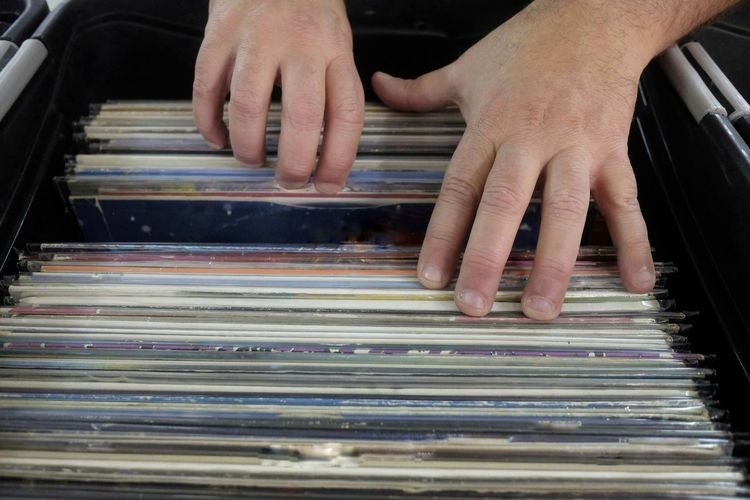 Cropped hands of man searching records