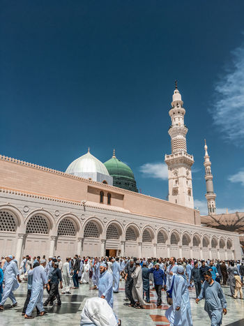 Architecture Masjidil Nabawi Madinah Adult Adults Only Architecture Blue Building Exterior Built Structure Clear Sky Day Dome Green Dome Islamic Architecture Large Group Of People Men Mosque Outdoors People Place Of Worship Real People Religion Sky Spirituality Travel Destinations Women