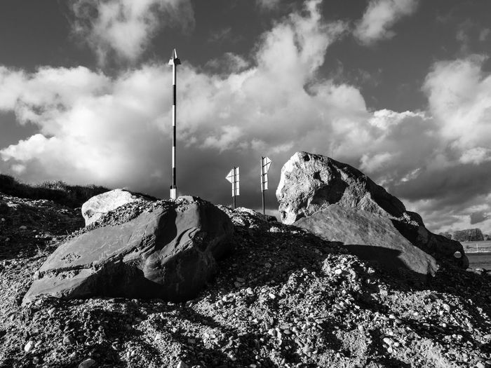 Black And White Cloud - Sky Day Low Angle View Nature Nature Outdoors Rocks Signpost Sky