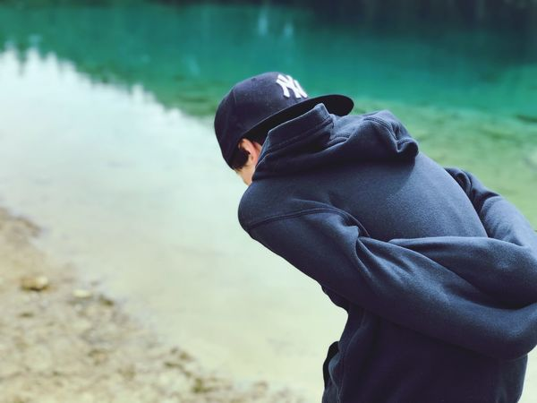 One Person Real People Water Lifestyles Day Focus On Foreground Inner Power Standing Casual Clothing Side View Cap Clothing Land Lake Outdoors Men Nature Leisure Activity Beach EyeEmNewHere