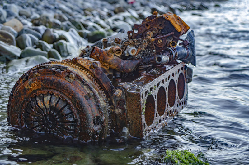 Close-up rusty the internal combustion engine in the water