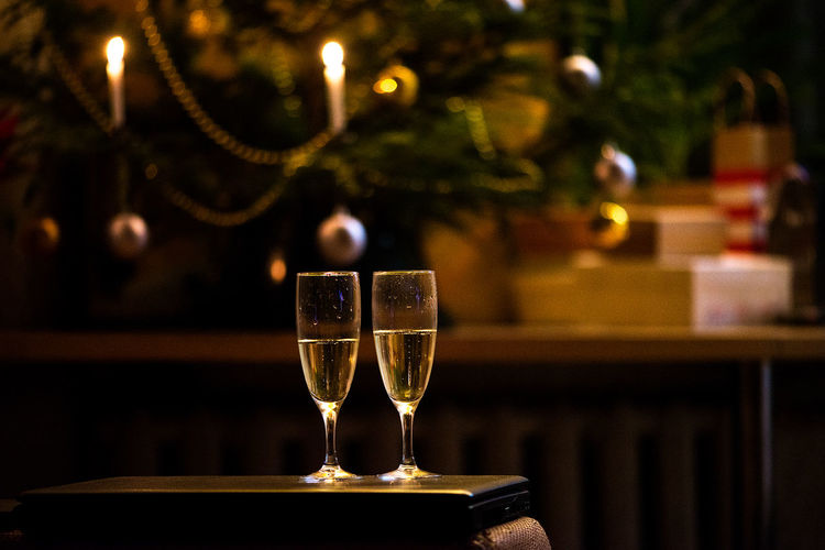 Christmas New Year Romantic Tree Alcohol Backgrounds Bokeh Celebration Champagne Champagne Flute Close-up Drink Drinking Glass Focus On Foreground Food And Drink Indoors  New Year Eve Night No People No People, Party Table Two Glasses Wine Wineglass Shades Of Winter