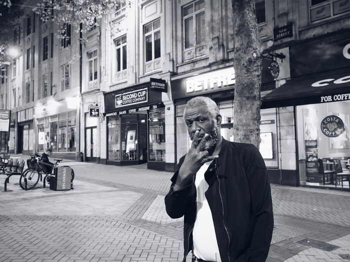 "Cities At Night People: Monday night, around quarter past 9, a man approached me and asked: ""Do you have any spare change?"" After telling him that I dont keep change on me, he replied: ""Ok, My names Paul. I'm well known in the Birmingham area. Take my picture, post it and see how many likes you get."" Streetphotography Walking Around Nighttime Birmingham UK Portrait Interestingpeople Olympus OM-D EM-1 Olympus Olympusinspired Getolympus Thestreetphotographer2016eyeemawards People And Places People And Places Peopleandplaces Peopleandplaces ThePhotojournalist2016eyeEmAwards"