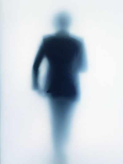 Close-up of business man over white background