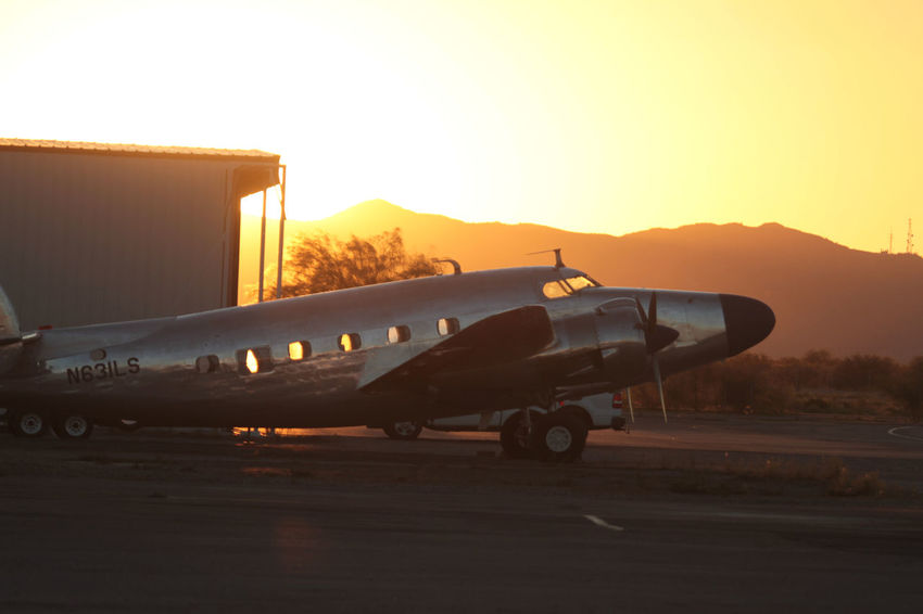 Arizona Sun Rise Air Vehicle Airplane Airport Airport Runway Beach Craft Clear Sky Day Desert Heat Mountain No People Outdoors Propeller Airplane Runway Transportation
