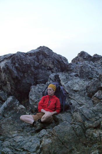 caucasian female hiker resting next to her backpack on a rocky alpine trail Alpine Backpacking Boots Camping Expedition Freedom Hiking Nature Sitting Travel Trekking Woman Active Activity Adventure Caucasian Climbing Copy Space Day Female Fit Healthy Lifestyle Hobby Leisure Activity Lifestyles Mountain Nature One Person Outdoors Outside People person Real People Resting Rock Rock - Object Rock Formation Sitting Sky Solid Sport Trail