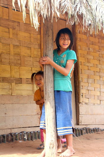 Young Adult Child Sisters Smiling Happy Money Doesn't Buy You Happiness Money Doesnt Matter Loas Remote Village Jungle Village Pauvrety