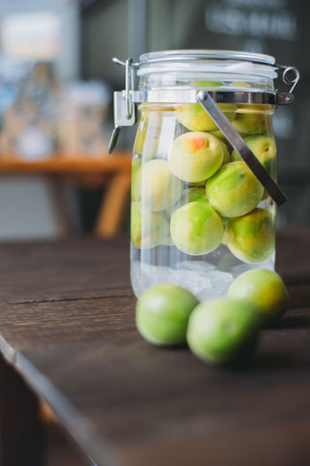 Fruits in jar on table