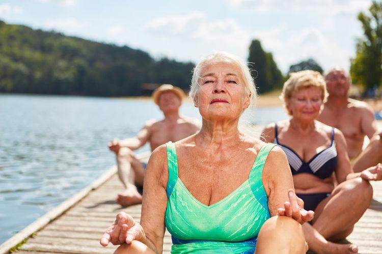 Women sitting by lake