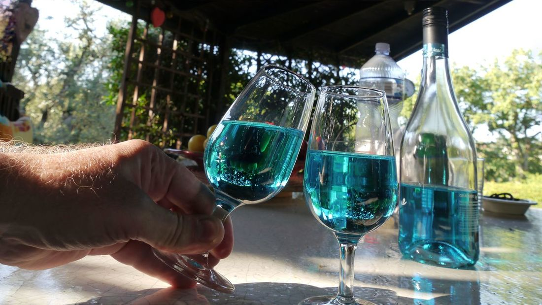 salute, cheers and Prost Turquoise Colored Modern Drink Salute Cheers ! Wine Glasses Wine Bottle Hand Of Man Holding A Glass Turquoise Colored Still Life Photography Still Life EyeEm Gallery Focus On Foreground Summer Vibes Human Hand Water Wineglass Men Alcohol Wine Males  Beverage Served
