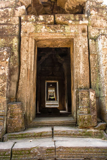 Angkor Wat Door Way. Accient Angkor Wat Architecture Building Exterior Built Structure Carving Cultures Day Door Doorway Entrance History No People Outdoors Place Of Worship Steps Stone Stonemason Temple Tourism Travel Destinations Tunnel