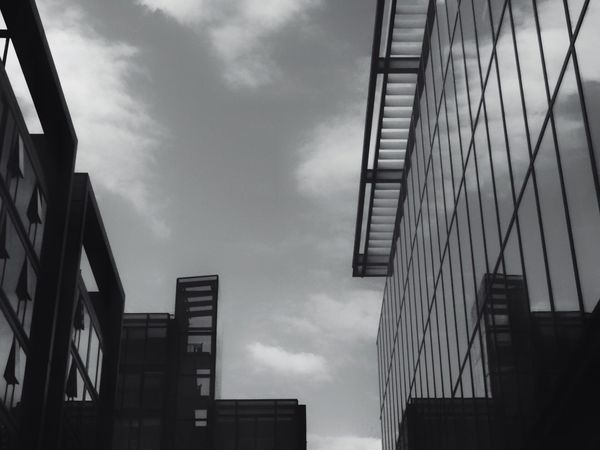 Glass Monochrome Reflections Architecture Urban Modernist Steel Street Photography Building Exterior Sky Clouds Mirrored Reflection