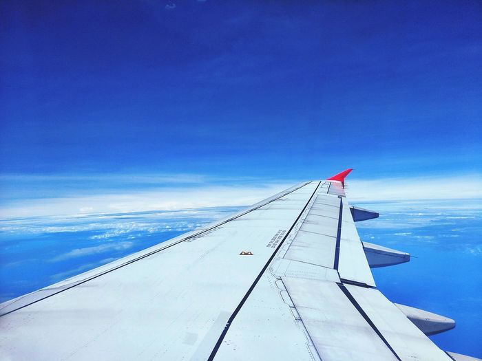 the red tip of airplane wing in blue sky Sky And Couds Bulesky Nature EyeEm Nature Lover Passenger Sea Airplane Blue Sky Airplane Wing Aeroplane Airways Trail Flight Air Vehicle Aircraft Aerial View