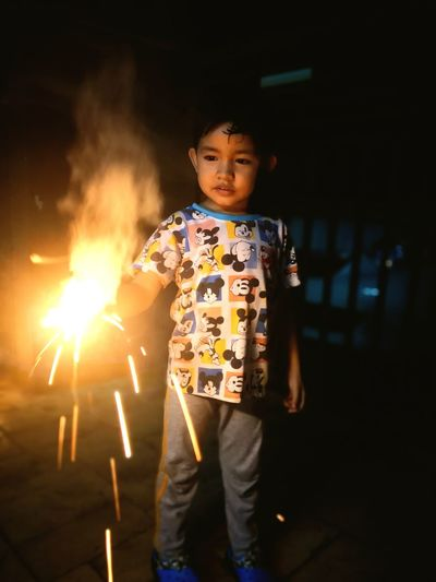 Fireworksphotography Fire Kids Fun Funtimes EyeEm Selects Child Childhood Portrait Standing Full Length Boys Flame Burning Lit