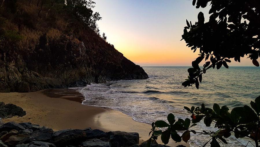 Yorkeys Knob winter sunset, Cairns QLD Yorkey's Knob Cairns Queensland Far North Tropical Climate Tropics Cliff Water Sea Sunset Beach Tree Silhouette Wave Rock - Object Sky Tide Coast Surf Coastline Rocky Coastline Seascape Calm Shore Ocean Sandy Beach Coastal Feature