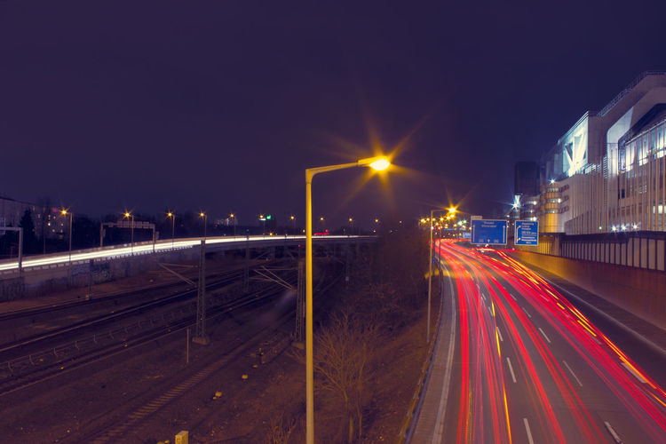 Blurred Motion Building Exterior Built Structure City Clear Sky Diminishing Perspective ICC Illuminated Light Trail Lighting Equipment Long Exposure Motion Night Road Sky Speed Stadtring Street Street Light The Way Forward Transportation Vanishing Point