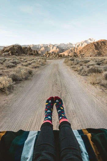 Life on the road. Waking up with cozy socks and a wonderful view. Alabama Hills From My Point Of View Mountain View Sky And Clouds Soft Light Arid Climate Beauty In Nature Blue Sky Desert Feet Selfie Female Model Human Foot Human Leg Lifestyle Photography Mountain Range On The Road One Person Outdoors Personal Perspective Real People Road Road Trip Scenics - Nature Selfie Sunrise Visual Creativity Summer Exploratorium Summer Exploratorium Summer Road Tripping The Traveler - 2018 EyeEm Awards A New Beginning It's About The Journey Moments Of Happiness