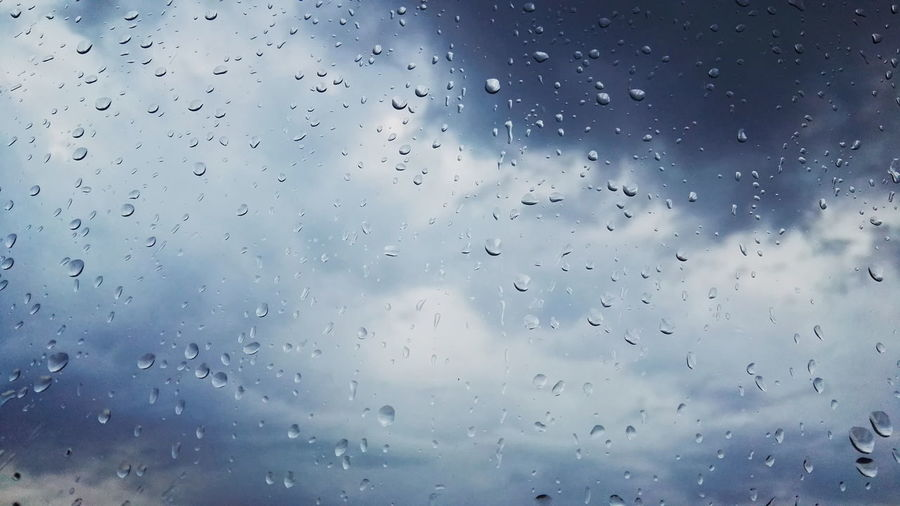 Drop Backgrounds Window Wet Sky No People Nature Cloud - Sky RainDrop Water Indoors  Day Rain Weather Clouds And Sky Clouds Capture The Moment Full Length Extreme Weather EyeEm Nature Lover EyeEm Best Shots - Nature Tranquility Tranquil Scene Colorful Full Frame