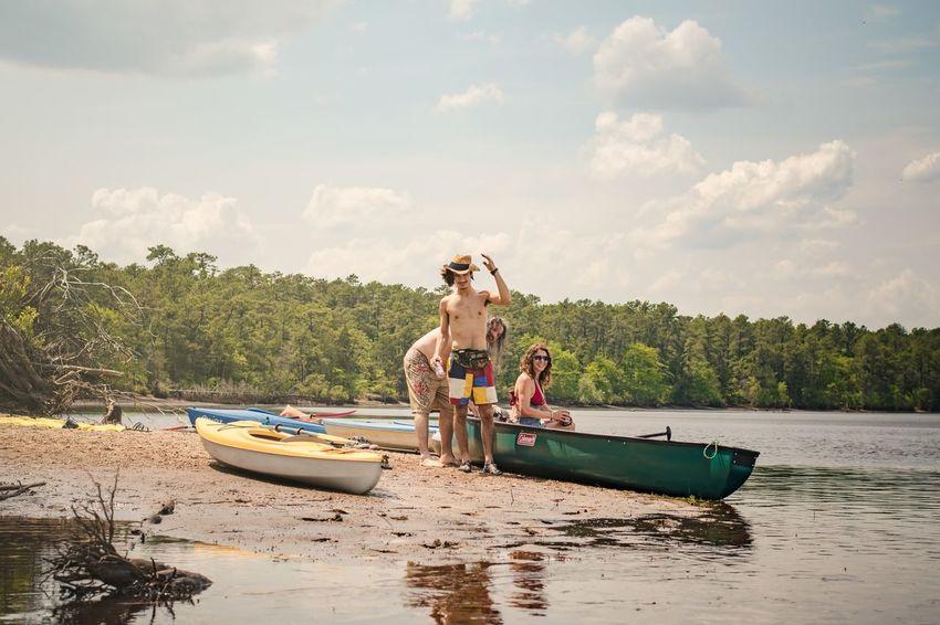 Kayaks and Canoes on a Riverbank River Kayak Family Summer Water Nautical Vessel Oar Full Length Tree Sitting Men Togetherness Kayak Lake Canoe Rowing Paddling Recreational Boat The Great Outdoors - 2018 EyeEm Awards