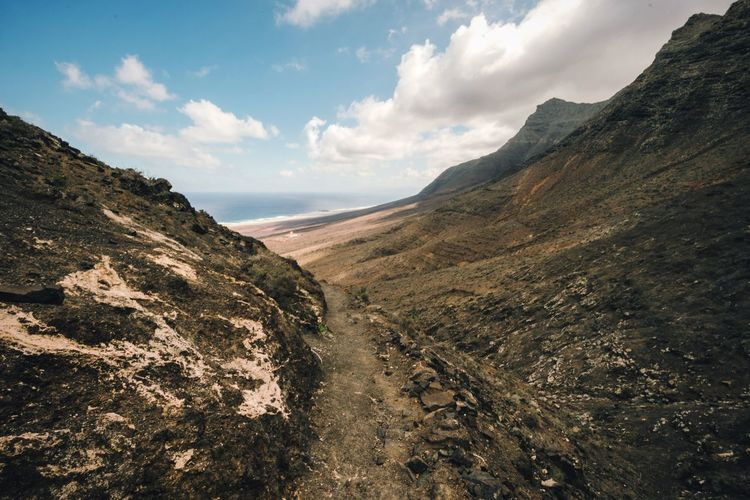 Path to the ocean Fuerteventura Tranquility Clear Sky Jandia Scenics Nature Mountain Beauty In Nature Landscape Mountain Range Outdoors Cofete No People Hiking Trekking Hiking Trail SPAIN Canary Islands Path Mointain View Coastline The Great Outdoors - 2017 EyeEm Awards Desert Cliff Narrow Street
