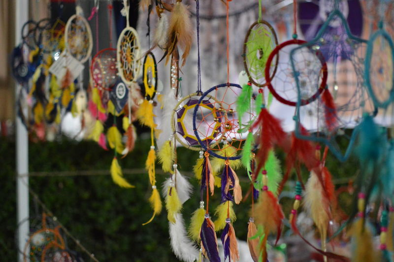 Close-up of dreamcatchers hanging for sale