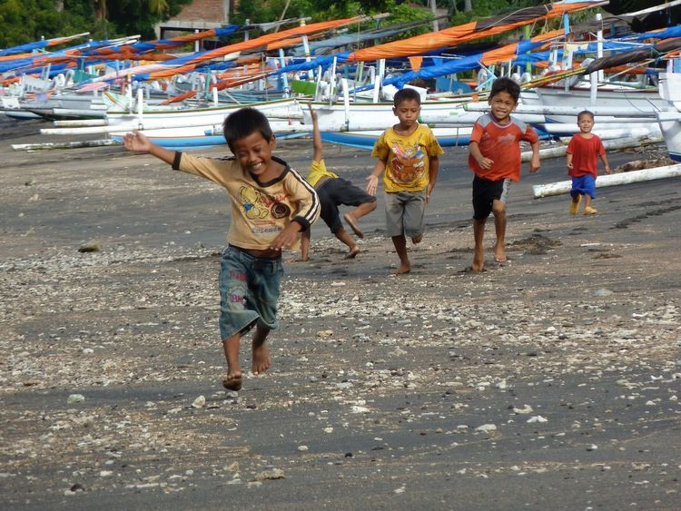 Finding New Frontiers Child Happiness Smiling Playing Running Beach Fun Nature Enjoyment Discovering Bali Meeting New People Colorful Pleasure Simplicity People Big Memories Fresh On Eyeem  BYOPaper! The Portraitist - 2017 EyeEm Awards The Photojournalist - 2017 EyeEm Awards Live For The Story Connected By Travel
