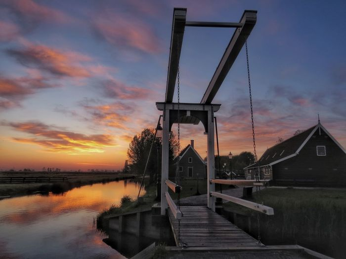 Zaanse Schans, Holland Architecture Beauty In Nature Bridge - Man Made Structure Built Structure Cloud Cloud - Sky Cloudy Dramatic Sky Holland Idyllic Nature No People Orange Color Outdoors Reflection Rippled Scenics Sky Sunset Tranquility Travel Destinations Water Zaanse Schans