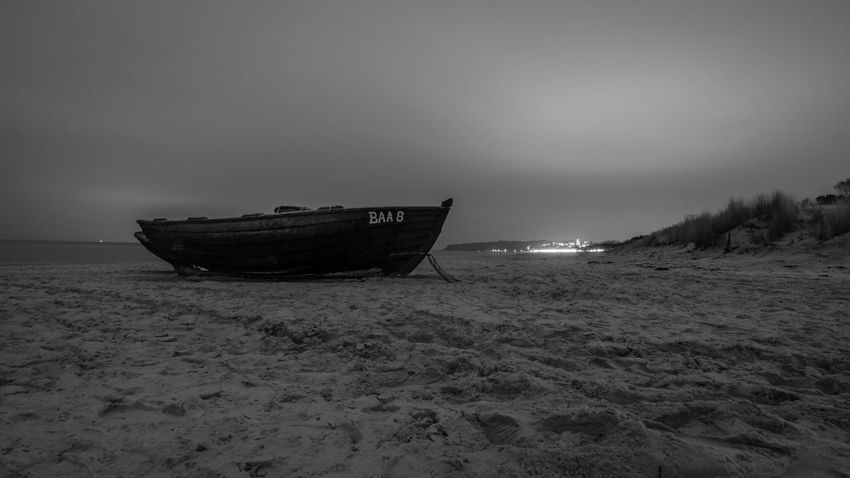 the fishing boat Baltic Sea Abandoned Beach Beauty In Nature Blackandwhite Boat Damaged Day Fisherman Boat Fishing Boat Horizon Over Water Mode Of Transport Moored Nature Nautical Vessel No People Outdoors Sand Scenics Sea Shore Sky Tranquility Transportation Water