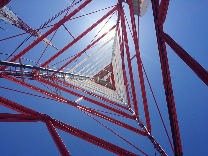 Underneath a communications tower. Tower Sun Crystal Clear Geometric Shapes