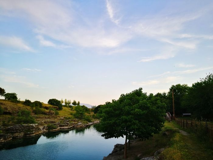 Tree Water Lake Nature Outdoors Landscape Cloud - Sky Tranquility No People Sky Vacations Blue Travel Destinations Scenics Sunset Beauty In Nature Day Tree Area The Street Photographer - 2017 EyeEm Awards City Cityscape Urban Skyline Downtown District Suspension Bridge Mode Of Transport