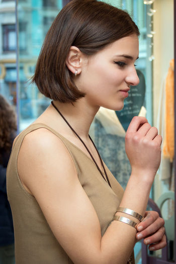 Side view of young woman looking away