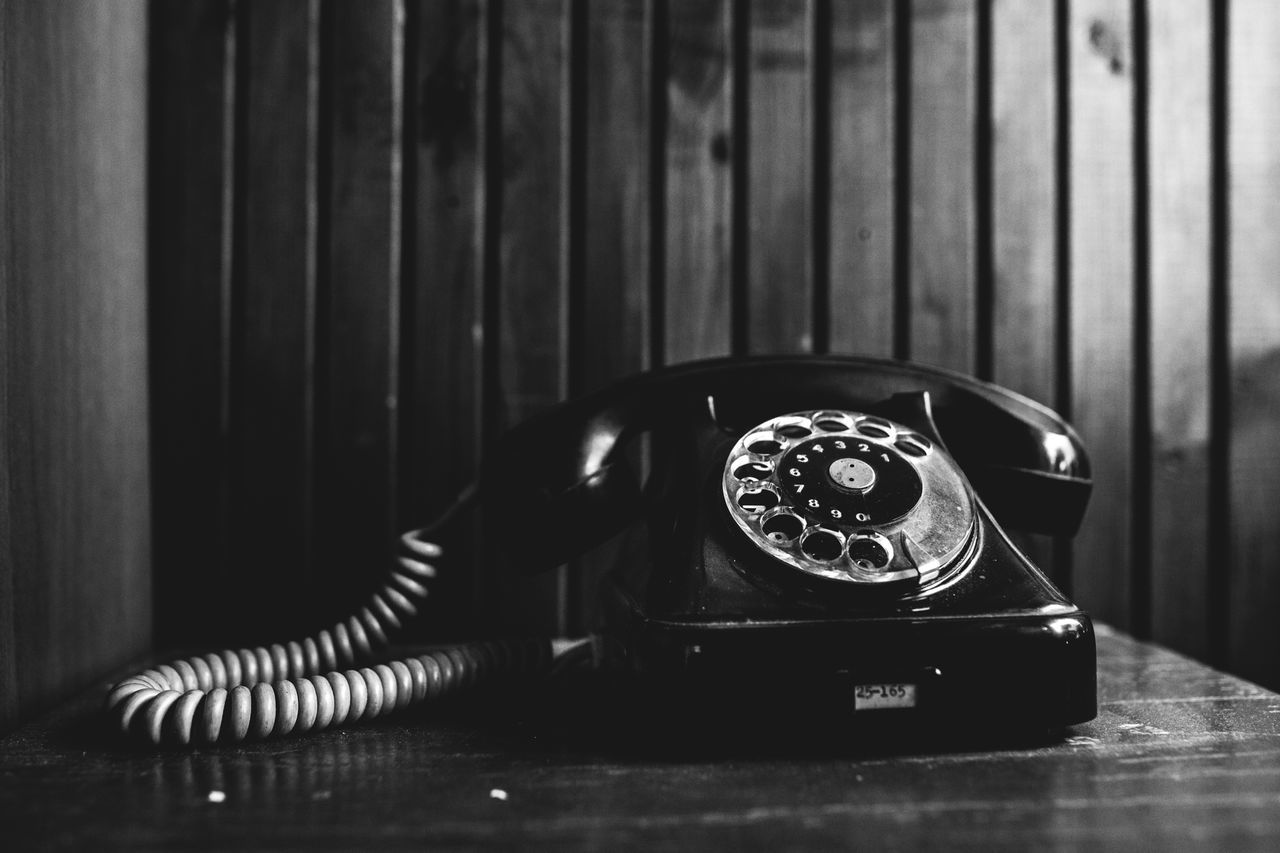 retro styled, telephone, technology, communication, landline phone, connection, indoors, table, rotary phone, no people, vintage, close-up, nostalgia, telephone receiver, analog, still life, antique, history, the past, phone cord