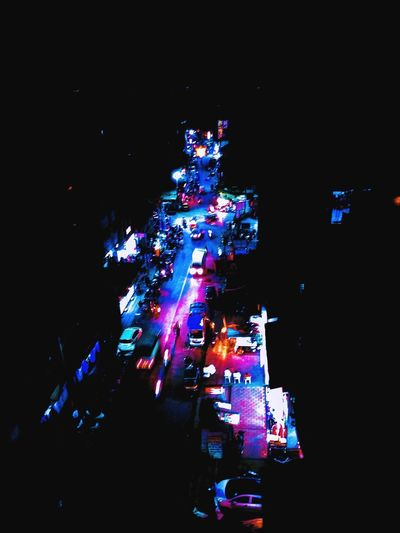 High angle view of illuminated city street at night