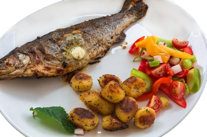 Roasted trout on white plate with lemon and roasted potatoes. Close-up Day First Eyeem Photo Fish Food Food Food And Drink Food And Drink Freshness Fried Potatoes Healthy Eating Indoors  Meat No People Plate Ready-to-eat Serving Size