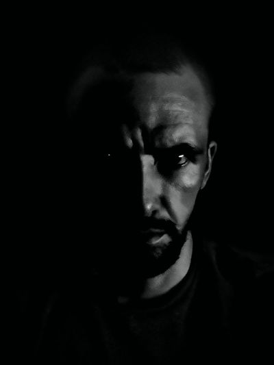 Black Background Portrait Looking At Camera Human Face Headshot Film Noir Style Focus On Shadow HUAWEI Photo Award: After Dark