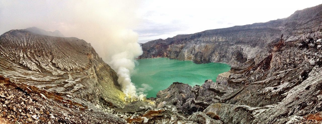 Ijen Volcano At Lake By Mountain