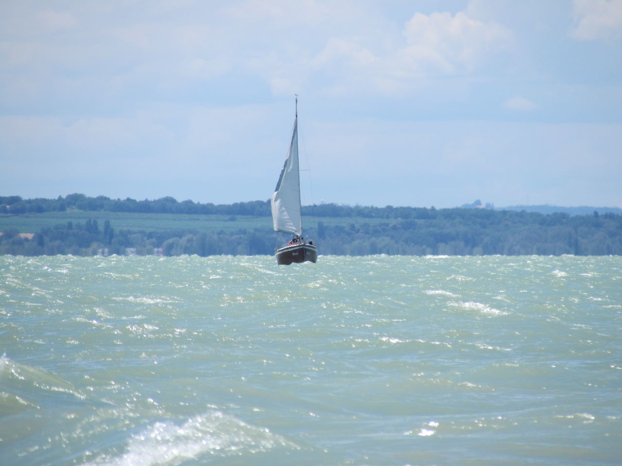 sea, waterfront, sky, water, sailboat, day, cloud - sky, nautical vessel, nature, outdoors, mast, sailing, transportation, real people, men, beauty in nature, scenics, sport, one person, scenery, people