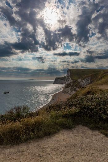 Bat's Head Dorset Jurrasic Coast Dramatic Sky seaview Seascape cliffs Southwest Coast England🇬🇧 World Heritage Site Cliffwalking seashore Sunrays