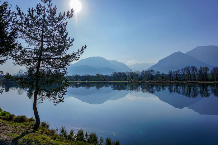 Austria Against The Sun Beauty In Nature Day Lake Misty Mountains  Mountain Mountain Range Nature No People Outdoors Reflection Scenics Sky Tranquil Scene Tranquility Tree Water EyeEmNewHere