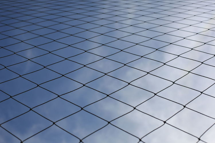 sky net Backgrounds Barrier Boundary Chainlink Fence Crisscross Day Design Fence Full Frame Grid Low Angle View Metal Nature No People Outdoors Pattern Protection Repetition Safety Security Shape Sky