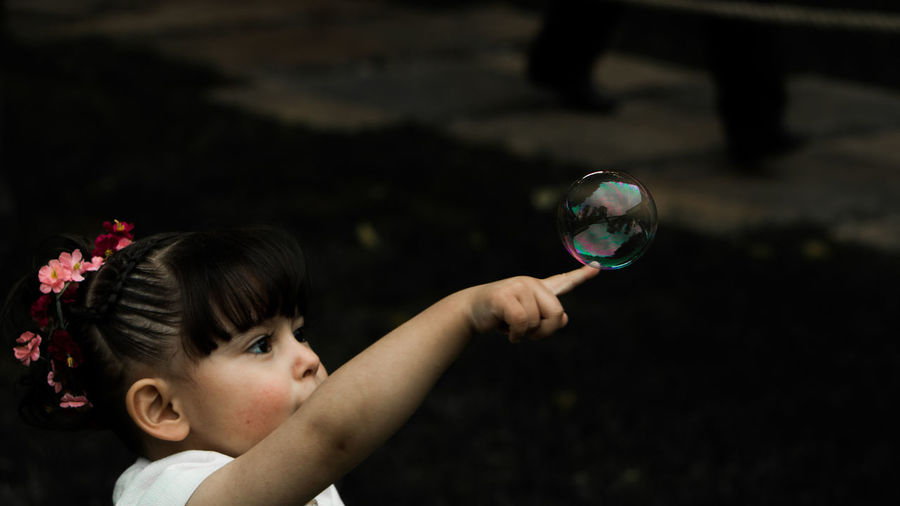 Bubble Bubble Wand Child Childhood Children Only Close-up Day Fragility Holding Human Body Part Human Hand One Girl Only One Person Outdoors People Planet Earth Soap Sud