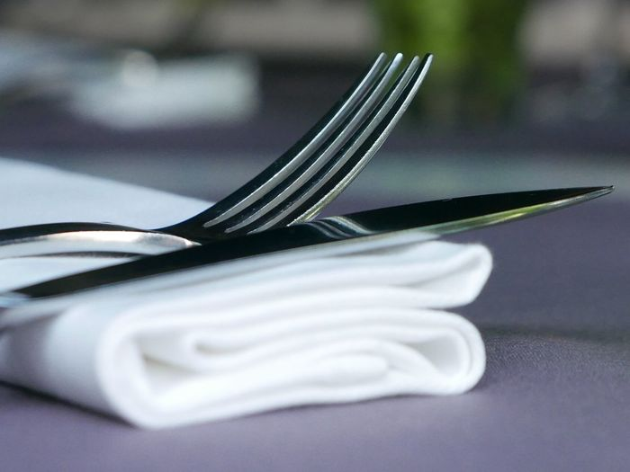 Close-up of fork and knife on napkin