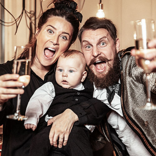Parenthood. Moms & Dads Group Of People Men Togetherness Males  Emotion Portrait Drink Adult Smiling Indoors  Refreshment Happiness Bonding Looking At Camera Family Young Adult Parent Mid Adult Son Mouth Open Glass Champagne New Year Parents