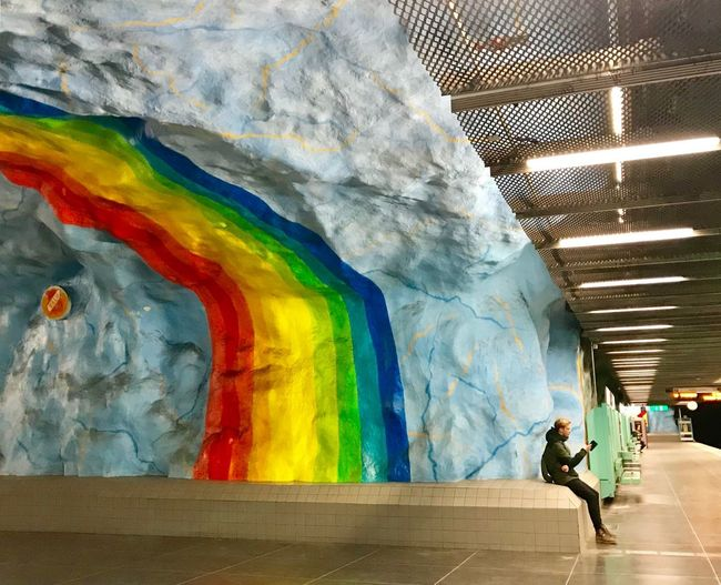 Sweden Stockholm ShotOnIphone Metro Station Metro Art Multi Colored Creativity Architecture Art And Craft Graffiti People Indoors  Day Leisure Activity Pattern Rear View Men Wall - Building Feature Real People Built Structure Lifestyles Underpass City