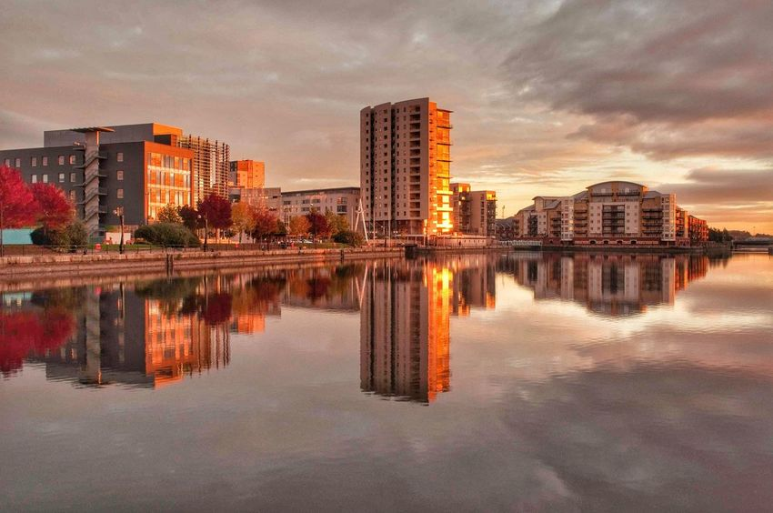 EyeEm Selects Reflection Cityscape Urban Skyline Symmetry City Water Sky Architecture Outdoors Sunrise Cardiff HDR Golden Hour Cloud - Sky No People